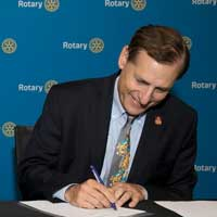 Rotary International General Secretary John Hewko signing the partnership